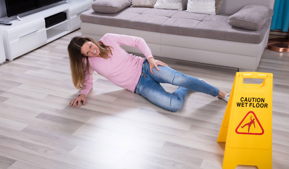 mature woman falling on wet floor